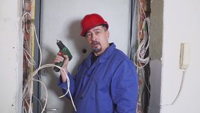 One electrician at work laying wiring cable with equipment and tools. Screwdriver. One electrician at work laying wiring cable stock video