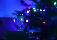 One empty wine glass and abstact night blury defocus bokeh light background photography Royalty Free Stock Images