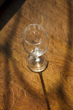 One empty wine glass on a wooden table Stock Photo