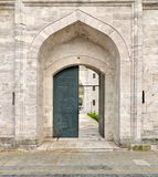 One of the entrances leading to the court of Suleymaniye Mosque. Istanbul, Turkey - April 17, 2017: One of the entrances leading to the court of Suleymaniye Stock Photo