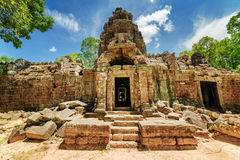 One of entrances to ancient Ta Som temple, Angkor, Cambodia. One of entrances to ancient Ta Som temple on blue sky background. Enigmatic Ta Som nestled among Royalty Free Stock Photography
