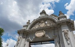 One of the entry arcs to Parque del Buen Retiro in front of blue sky, Madrid stock photos