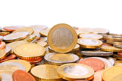 One Euro. Many Coins with one Euro in the middle Royalty Free Stock Photography