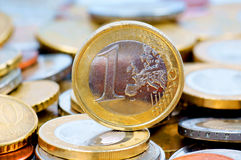 One Euro. Many Coins with one Euro in the middle Royalty Free Stock Image