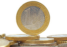 One Euro. Many Coins with one Euro in the middle Royalty Free Stock Photos