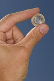 One euro. Hand holding one euro Stock Photography