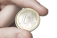 One euro. Hand is holding a one euro coin Royalty Free Stock Photography