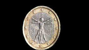 One euro back coin isolated on black background stock video