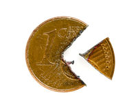One Euro-Cent coin cut into pieces. A one Euro-Cent coin cut into two pieces Stock Image