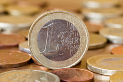 One euro coin. In a  middle of other coins Royalty Free Stock Photos