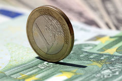 One euro coin. On a one hundred euro banknote Royalty Free Stock Photography