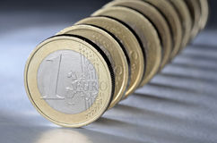 One euro coin. In front of a euro coins row Stock Photography