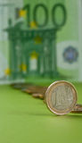 One  euro coin. One hundred Euro bill and coins Royalty Free Stock Images