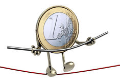 One euro coin acrobat who walks on a wire. Concept of finacial risk Royalty Free Stock Images
