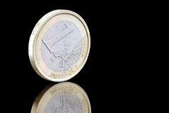 One euro coin. One euro coin on a black background with reflection Royalty Free Stock Photos