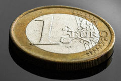 One euro coin. Close uo view, black background Stock Photos