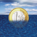 One euro coin drowning in sea, close-up Stock Photography