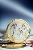 One euro coin on the edge. Euro money currency. Euro coins stacked on each other in different positions Royalty Free Stock Photos