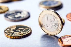 One euro coin on the edge. Euro money currency. Euro coins stacked on each other in different positions.  Royalty Free Stock Photo