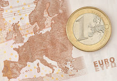One Euro Coin on Euro Banknote Royalty Free Stock Photos