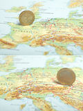 One euro coin on a European map (France/Austria) Royalty Free Stock Photography