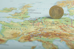 One euro coin on a European map (Germany) Royalty Free Stock Image