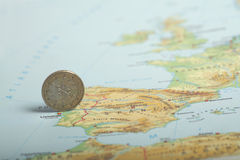 One euro coin on a European map (Portugal) Royalty Free Stock Photo