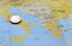 One Euro coin on a  European map Royalty Free Stock Photography