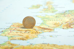 One euro coin on a European map (Spain) Stock Image