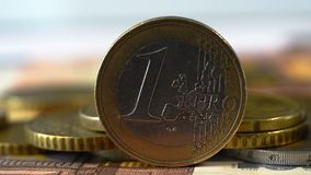 One Euro Coin. Extreme Close Up One Euro Coin On Stack Of Many Euro Coins And Banknote stock video