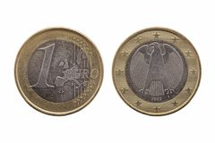 One Euro coin of Germany. Dated 2002 which shows the German eagle on the reverse cut out and isolated on a white background stock images