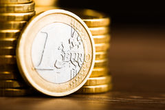 one euro coin and gold money Royalty Free Stock Images