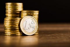 One euro coin and gold money Stock Images