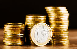 One euro coin and gold money Stock Photo