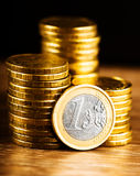One euro coin and gold money Stock Photography