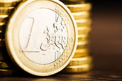 One euro coin and gold money on the desk Stock Photo
