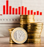 One euro coin and gold money on the desk Royalty Free Stock Photo