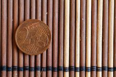 One euro coin lie on wooden bamboo table Denomination is 2 euro cent Royalty Free Stock Photo