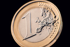 One euro coin macro view over black Royalty Free Stock Image