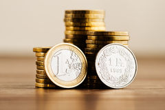 One euro coin and one swiss frank Stock Photos