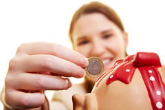 One Euro coin in piggy bank Royalty Free Stock Photo