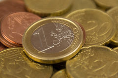 One euro coin on pile of euro coins macro Stock Image