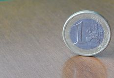 euro coin on the rigde on wooden background stock image