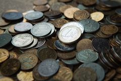 One euro coin on russian roubles coins stock photo