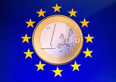 EU Coin. A one euro coin sitting in the middle of EU yellow stars stock images