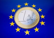 EU Coin. A one euro coin sitting in the middle of EU yellow stars royalty free stock photos