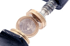 One-euro coin squeezed in vise Royalty Free Stock Photography