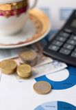 One euro coin and stacks of other on paper sheets Stock Photos
