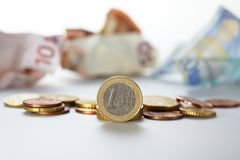 One euro coin standing Stock Images