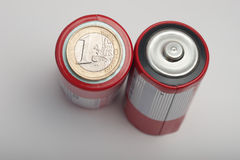 One euro coin on top of battery Royalty Free Stock Photo